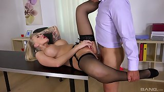 Top office MILF gets laid out of reach of the table then swallows jizz